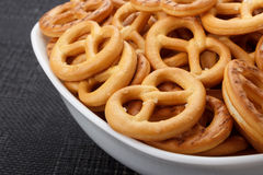 Pretzels in a white bowl. Closeup of some salted pretzels in a white bowl Stock Photo