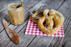 Pretzels with wholegrain mustard, food snack bread picnic Stock Photo