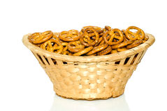 Pretzels in the wicker basket. Crackers in the wicker basket isolated on the white background Stock Image