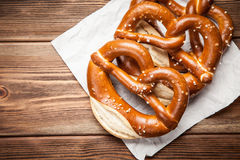 Pretzels on wooden table Stock Photography