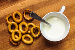 Pretzels and yogurt cup breakfast Royalty Free Stock Photo