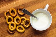 Pretzels and yogurt cup breakfast Royalty Free Stock Photo