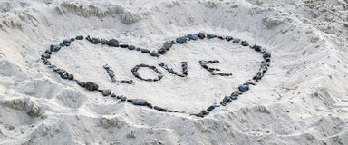 Preuve d'amour dans le sable Image libre de droits