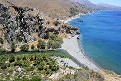 Preveli beach in Crete, Greece. The beautiful Preveli beach with its renowned for its palms and the beautiful  beach . It can be reached only on foot in half an Royalty Free Stock Images