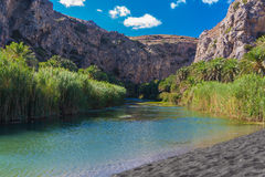 Preveli Great River. River Megas Potamos and rare black sand beach Royalty Free Stock Photos