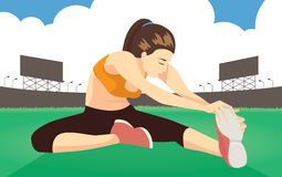 Prevent leg hurt with cool down stretches on field. Woman cool down stretches on field after run at stadium for prevent leg hurt Stock Photo