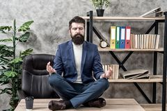 Prevent professional burnout. Man bearded manager formal suit sit lotus pose relaxing. Way to relax. Meditation yoga stock photos