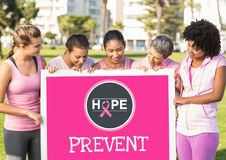 Prevent text and pink breast cancer awareness women holding card Stock Images