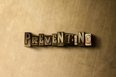 PREVENTING - close-up of grungy vintage typeset word on metal backdrop. Royalty free stock illustration.  Can be used for online banner ads and direct mail Royalty Free Stock Images