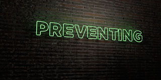PREVENTING -Realistic Neon Sign on Brick Wall background - 3D rendered royalty free stock image. Can be used for online banner ads and direct mailers Stock Photo