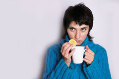 Prevention. In cold season it is so cosy to drink a cup of tea with lemon Stock Photography