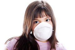 Prevention. Studio shot of young girl wearing protective mask, isolated on white Stock Photos