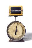 Prevention on an antique scale Stock Photography