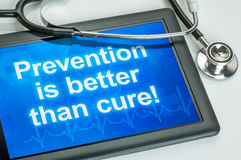 Prevention is better than cure. Tablet with the text Prevention is better than cure royalty free stock photography