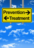 Prevention versus treatment on road sign Stock Image