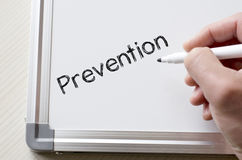 Prevention written on whiteboard. Human hand writing prevention on whiteboard Royalty Free Stock Images