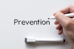 Prevention written on whiteboard. Human hand writing prevention on whiteboard Royalty Free Stock Photo