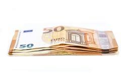 Preventivpiller av räkningpapper 50 eurosedlar på vit bakgrund Royaltyfri Foto