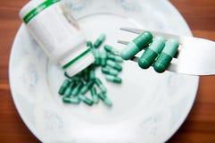 Preventivpillerar i en platta Arkivfoto
