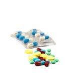 Preventivpillerar på vit bakgrund Royaltyfria Foton