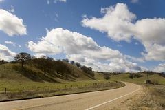 The Preverbial Curve In The Road. A shot of the curve in the road in a rural spot in the central valley of California Royalty Free Stock Photography