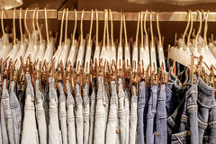 Preview jeans hanging on a hanger in the store Stock Image