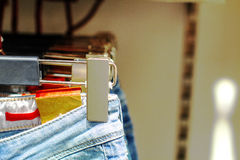Preview jeans hanging on a hanger in the store Royalty Free Stock Photography