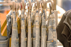 Preview jeans hanging on a hanger in the store Royalty Free Stock Photo