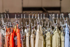 Preview jeans hanging on a hanger in the store Royalty Free Stock Images