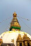 Prey flags swinging in the brezze. Temple Katmandu flags nepal blue sky Royalty Free Stock Photography