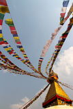 Prey flags swinging the brezze. Temple Katmandu flags nepal blue sky Royalty Free Stock Photos
