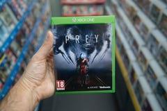 Prey videogame on XBOX One. Bratislava, Slovakia, circa april 2017: Man holding Prey videogame on Microsoft XBOX One console in store Stock Photos