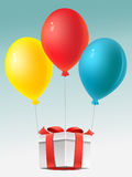 Prezent and balloons Stock Images