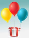 Prezent e balões Imagens de Stock
