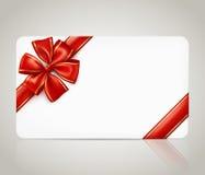Prezent karta z czerwonym tasiemkowym łękiem Zdjęcia Royalty Free