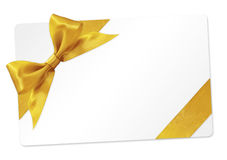 Prezent karta z złotym tasiemkowym łękiem Odizolowywającym na bielu Obraz Stock
