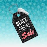 Prezzo da pagare di carta realistico di vendita di Black Friday su fondo con neve ed i fiocchi di neve Royalty Illustrazione gratis