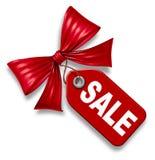 Prezzo da pagare di vendita con il legame di arco rosso del nastro Immagine Stock Libera da Diritti