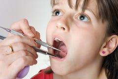 Prüfung der Zähne Stockfotos
