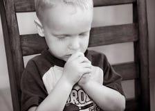 Prière d'enfant Photographie stock libre de droits