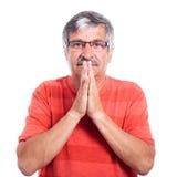 Prière d'homme aîné Images libres de droits