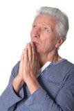 Prière d'homme aîné Photo libre de droits