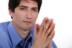 Prière d'homme d'affaires photos stock