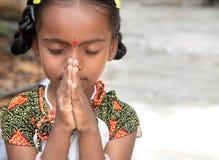 Prière de petite fille Image stock