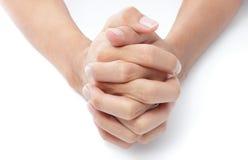 Prière pliée de mains Image stock