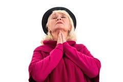 Prière pluse âgé de dame d'isolement photo stock