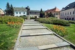 Pribina statue and blooming orange tulips, Nitra, Slovak republi. C. Seasonal natural scene. Architecture and gardening. Outdoor scene Royalty Free Stock Images
