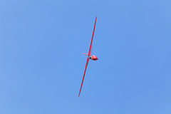 PRIBRAM, CZECH REPUBLIC - 29 MAY 2010: Unpowered red  glider aerobatics shows over the airport on a beautiful sunny day. Czech Republic Royalty Free Stock Images