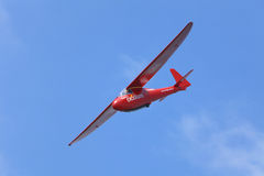 PRIBRAM, CZECH REPUBLIC - 29 MAY 2010: Unpowered red  glider aerobatics shows over the airport on a beautiful sunny day. Czech Republic Stock Images