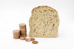 Price of bread. Bread and copper coins. Economy concept illustrating growing cost of living and rising price of bread royalty free stock image